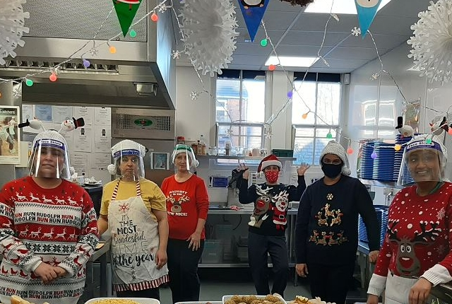 Catering staff serving Christmas dinner