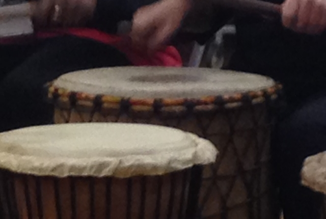 Picture of staff playing african drums