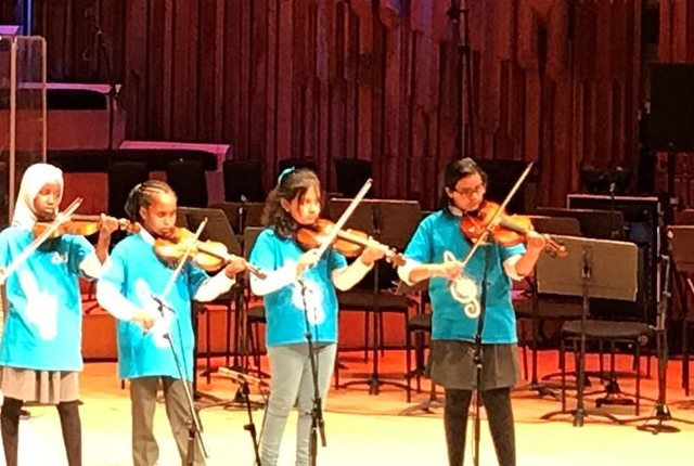 Picture of Ark Tindal violinists playing at the Ark Schools Music Gala