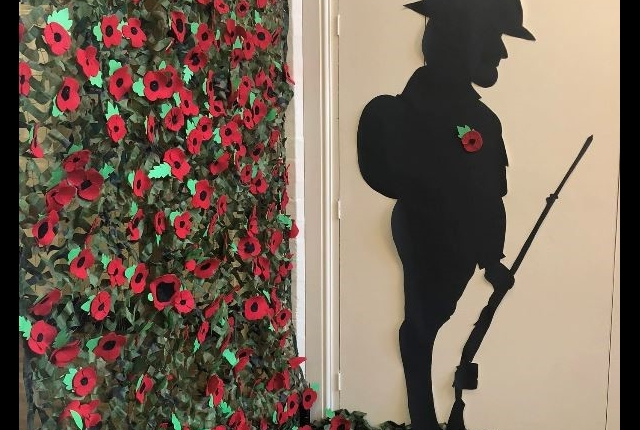 Remembrance river of poppies and soldier frieze