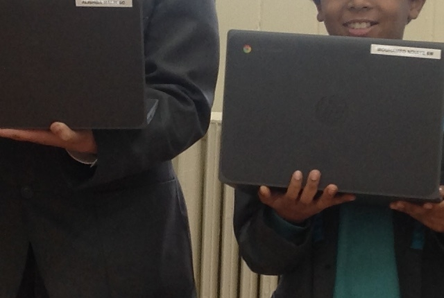 Year 6 pupils with their new laptops