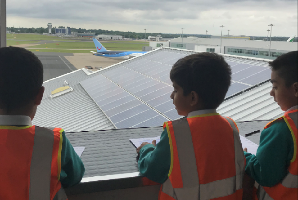 Pupils watch aeroplanes land