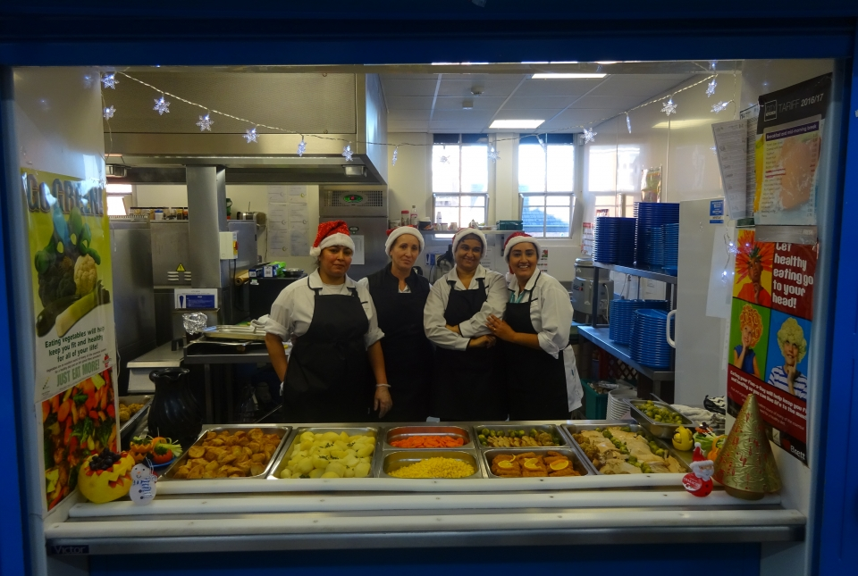 Kitchen staff serving Christmas lunch