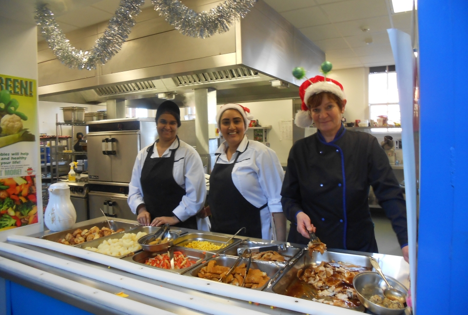 Picture of kitchen staff serving Christmas lunch
