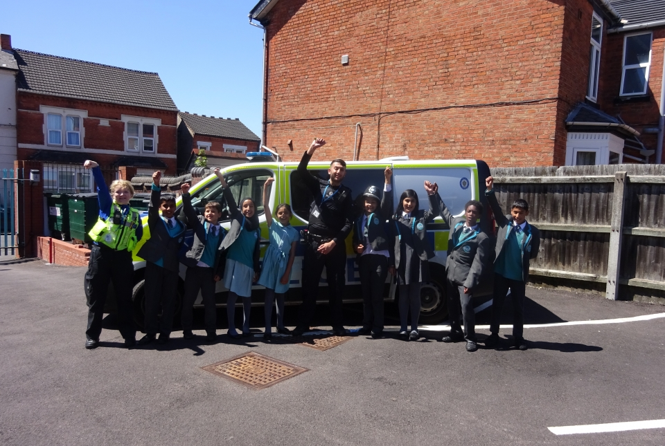 Police and pupils celebrate by the van