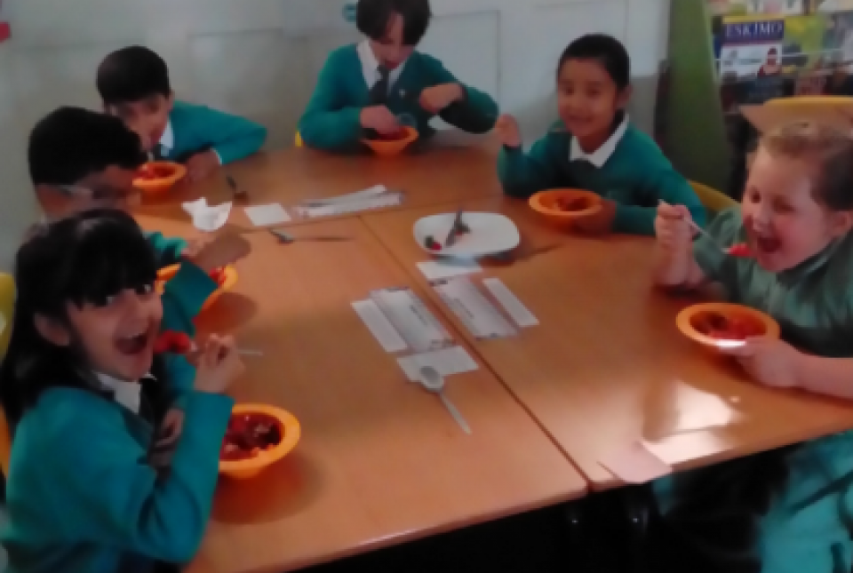 Pupils eating fruit salad made in science
