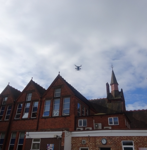 Picture of drone flying over school