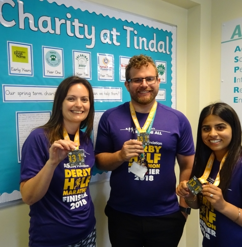 Staff members with medals