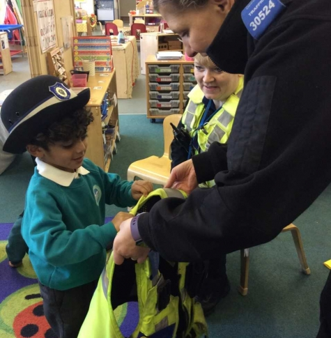 Pupil trying on police vest